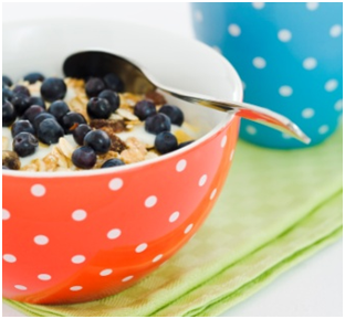 Bowl of high fibre cereal with blueberries